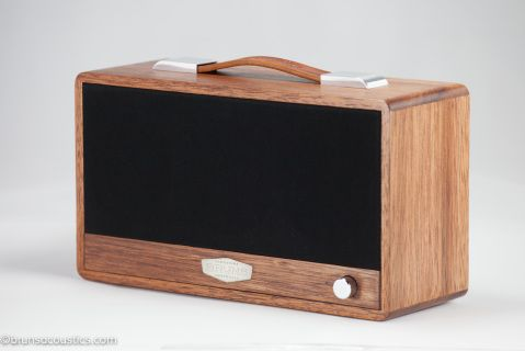 The Durian heartwood has a distinct pink-brown to deep red brown while the sapwood has much lighter white to pale pink-brown appearance.  Grain  matched from a single piece of Durian,  fitted with polished    hardware, hand dyed brown leather handle and a  solid black cloth grill.
