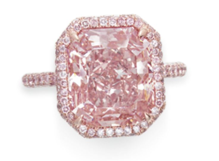 'The 6.89 Carat Fancy Vivid Purple-Pink Diamond' - The anonymous buyer paid $1 million per carat for the cut-cornered modified rectangular-cut fancy vivid purple-pink diamond set in a ring made of 18K rose gold; making this pink heart join the band of the most expensive diamonds auctioned this season.
