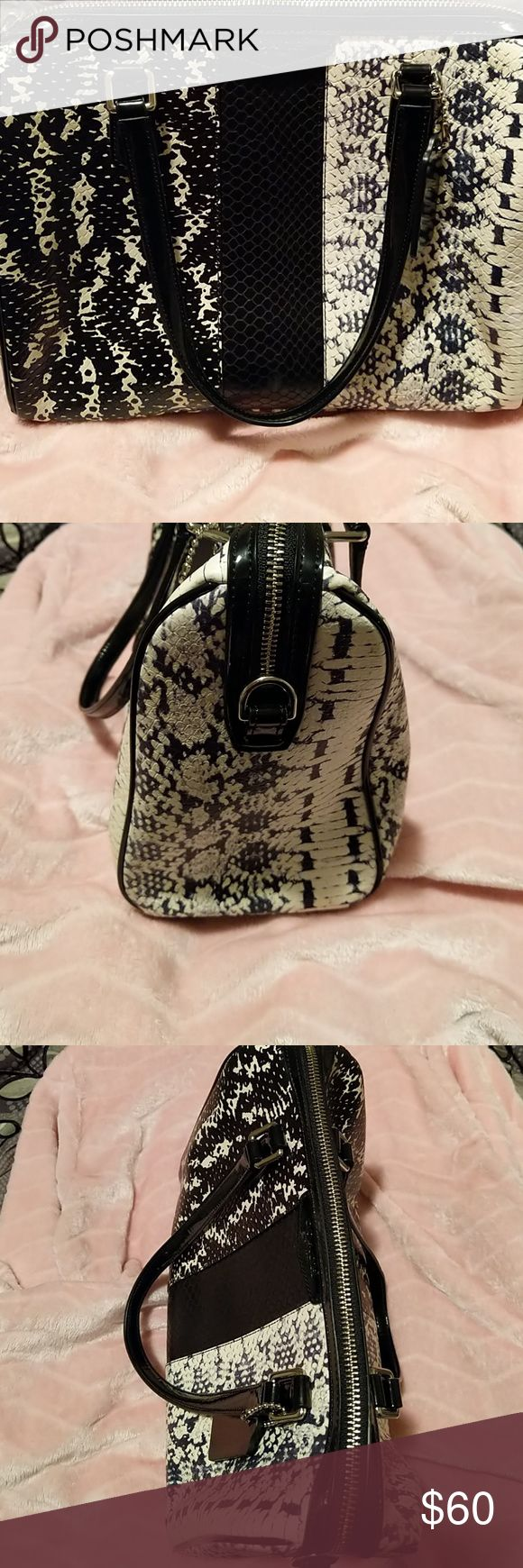 "Coach black and off-white satchel Like new, black and off -white textured handbag. 11 3/4"" long, 9"" tall, 5 1/2"" wide. Super cute, but no long strap or dust bag. Price is reflected. No rips, tears, stains or signs of wear. Coach Bags Satchels"