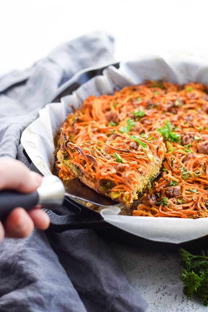 This Whole30 hash brown pie is made with spiralized sweet potato, eggs, kale and ground pork! Just combine the ingredients in a skillet and bake! GF, Paleo.