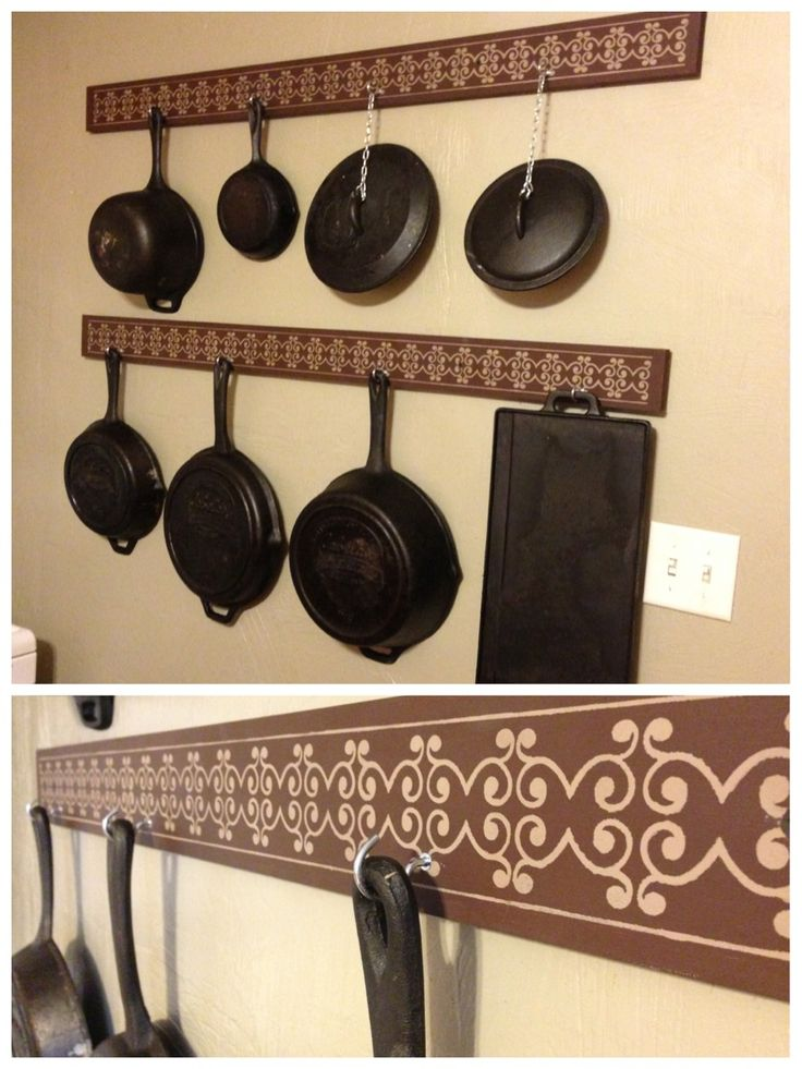 DIY cast iron storage! 1x4 boards painted and stenciled, coffee mug hooks to hang the pans. I used small chain and S hooks to hang the kids. Easy, efficient, stylish!