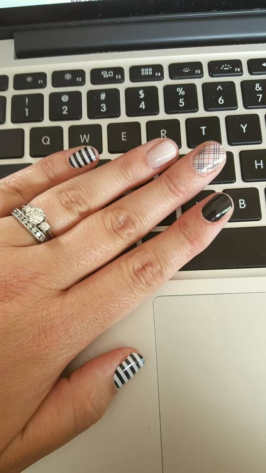 Muted manicure combo of Black & White Stripe, Almond Ombré (retiring), Upper East Side, and Darkest Black Jamberry nail wraps.