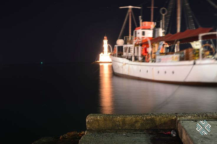 Chania at night. The lighthouse #chania #harbour #boat #lighthouse #crete #greece #passionforgreece