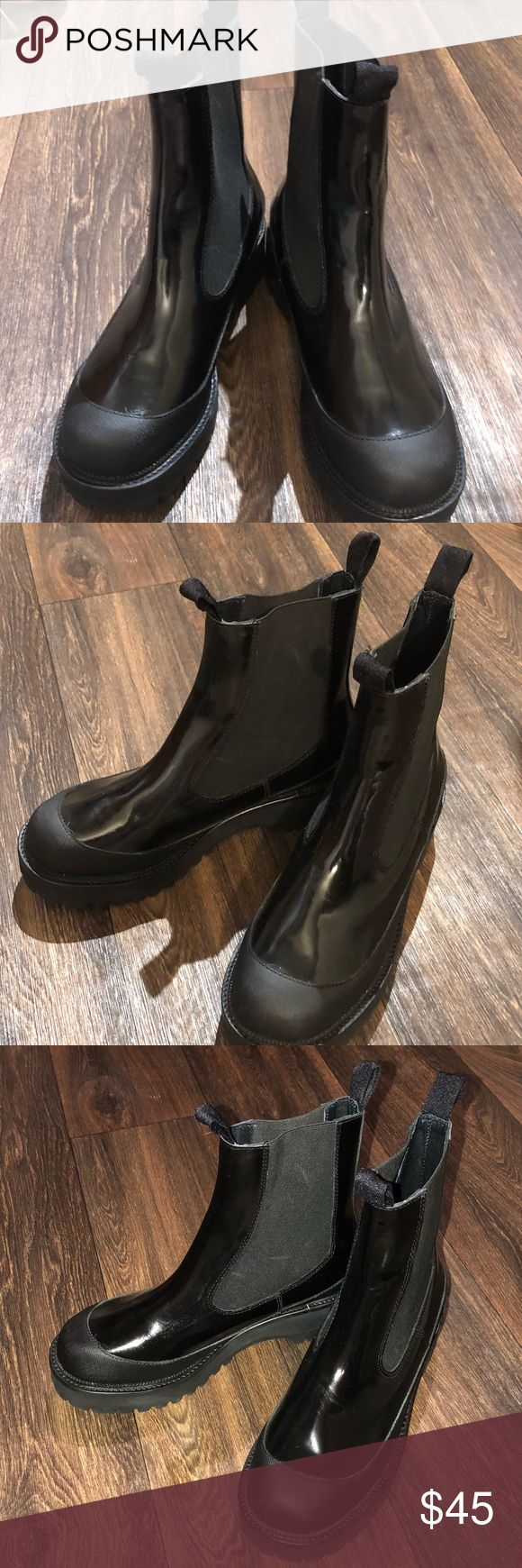 """Jeffrey Campbell El Niño glossy rain boots Size 9. Glossy black. Minor scuffing from being in display / being tried on. A classic Chelsea profile, oversized goring panels and a grippy ridged sole define a durable rain boot outfitted with a cushioned footbed and roomy round toe. 1 1/4"""" heel 6"""" shaft Pull-on style Cushioned footbed Synthetic upper, lining and sole Jeffrey Campbell Shoes Winter & Rain Boots"""