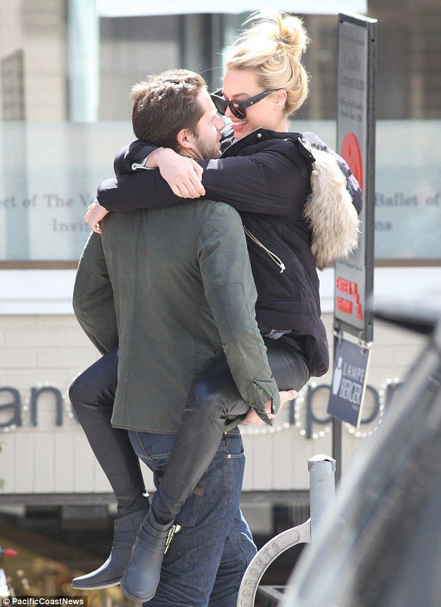 The look of love! The Wolf Of Wall Street star, who had just emerged from a spa, seemed overjoyed at seeing her beau and couldn't resist throwing her arms around his neck and her legs around his waist