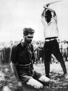 "A Japanese soldier, Yasuno Chikao, prepares to behead Australian Sergeant Leonard G. Siffleet at Aitape in New Guinea. The Australian commando from ""M"" Special Unit was captured while his small patrol was operating deep behind enemy lines. 1943. The photograph was discovered on the body of a dead Japanese major near Hollandia by American troops in April 1944."