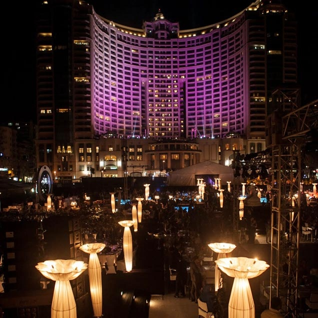 Custom lighting illuminated an outdoor wedding scene at @Mandy Bryant Dewey Seasons Hotel Alexandria at San Stefano, Egypt.