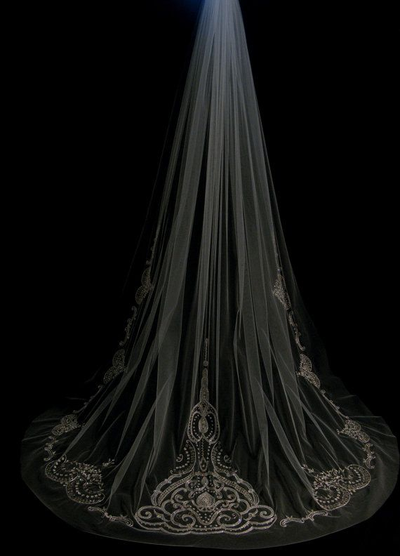 I like how the detail on this one is at the bottom... not taking anything away from the dress- Swarovski veil