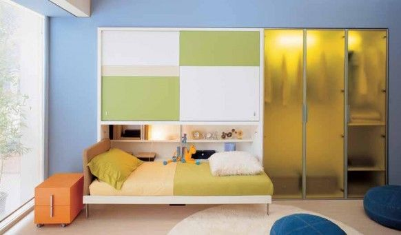 Teens Bedroom : Cool Colorful Teen Bedroom Interior Decor With Bright Lighting Ideas With Simple Teen Bedroom Design With Blue Wall And Green Glass Dress Closet Combined With Orange Toys Box And White Round Carpet On The Floor Cool Colorful Teen Bedroom Interior Decor with Bright Lighting Ideas Teenage Bedroom Furniture With A Mattress. Teenage Bedroom Accessories. Modern Bedroom.