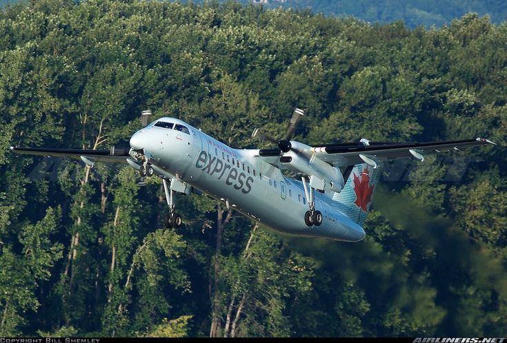 Air Canada Express De Havilland Canada DHC-8-301 Dash 8 C-GTAT departing Portland-International, July 2014. (Photo: Bill Shemley)
