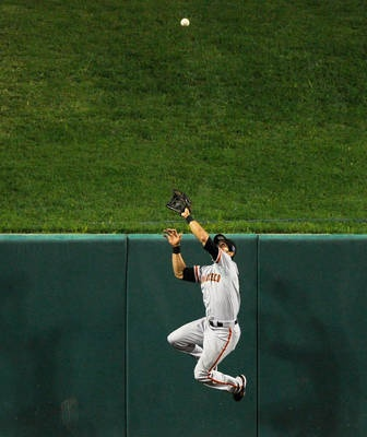 Giants center fielder Angel Pagan robs Cardinals catcher Yadier Molina of extra bases by making this leaping catch in the third inning.