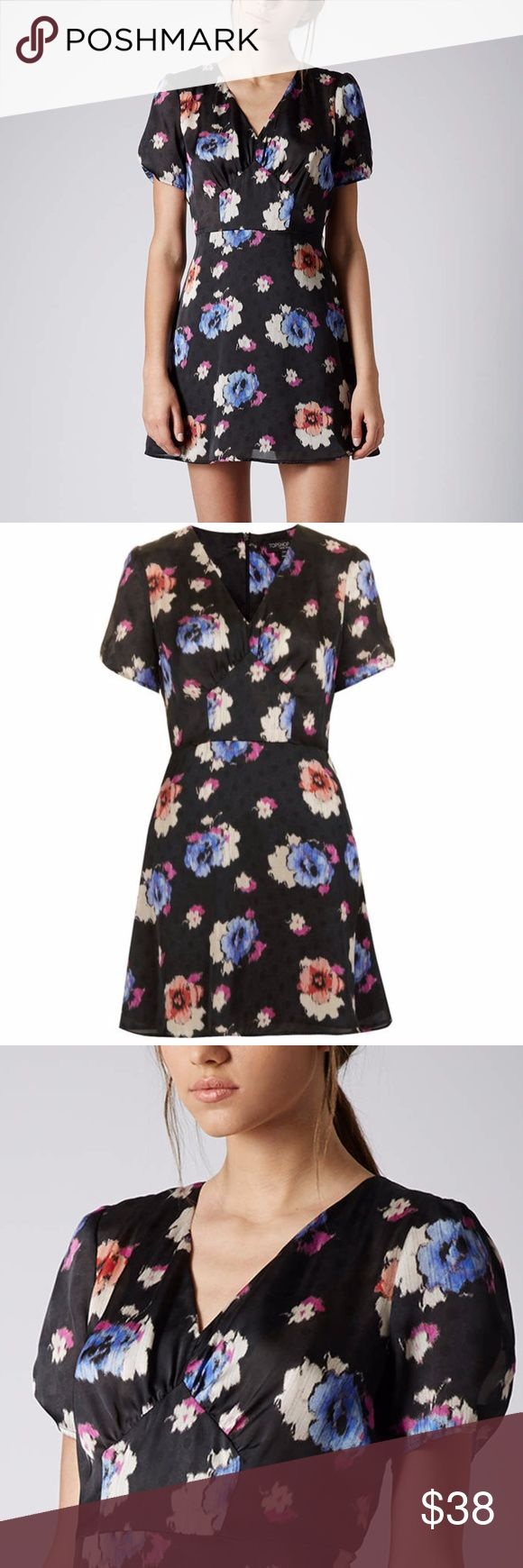 TOPSHOP Petite Spot Floral Tea Dress An exclusively petite dress from TOPSHOP with an all over floral rose print on top of a faded polka dot pattern in the background. Fastens up the back with a concealed zipper. Has a flattering v-neck line. Would probably need a slip underneath. Petite exclusive spot floral tea dress in black. 100% Polyester. Size 4P. In great used condition. No trades. Topshop PETITE Dresses Mini