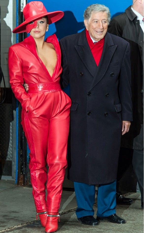 Lady Gaga steps out in a red leather jumpsuit, red hat and pointed red booties.