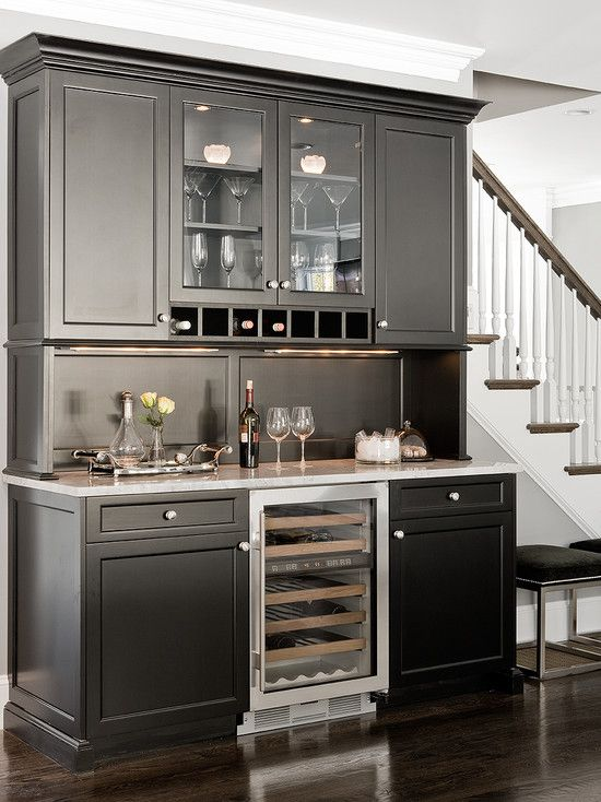 painting the built-in desk w/ upper cabinets in my kitchen like this, and putting beadboard wallpaper painted the same color between the desk and cabinets so it sort of looks like a hutch.    Great for media room