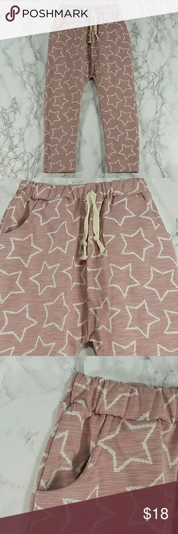 Light pink stars  Harem Sweatpants. Kids Adorable light pink harem sweatpants with stars design. Have pockets Pull up style.  This item is brand new and never used. No tags Bottoms Sweatpants & Joggers