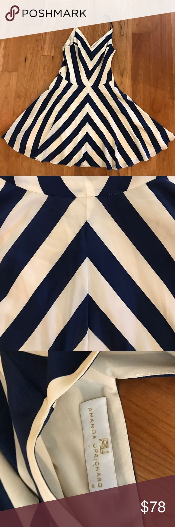 Amanda Uprichard navy chevron dress Only worn once to a wedding! I got so many compliments on this dress - it's so flowy and flattering. Sits above the knee - strappy and tighter at the waist. Amanda Uprichard Dresses Mini