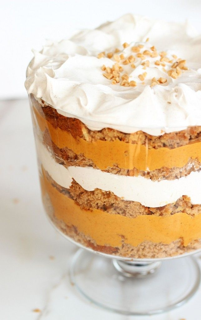 Mountains of cinnamon-spiced whipped cream tower over layers of pumpkin butterscotch pudding and box spice cake in this Thanksgiving trifle.
