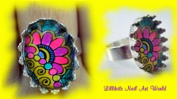 Querid@s Lilliputienses,    Como os decía ayer, aquí os enseño una manicura (con su anillo a juego) que me encantó lucir este veranito en la...