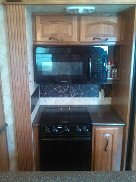 2012 Used Keystone Montana 3400RL Fifth Wheel in Florida FL.Recreational Vehicle, rv, Price just reduced...Four brand new Maxiss tires. Two mounted spares. Two batteries (1 new). Mor/ryde pin box. Under cabinet water filter in kitchen. Built in vacuum with attachments. Four slide awnings. King-sized bed. Two recliners. Dinette set. Flat screen TVs in LR and BR. Entertainment system with DVD player and surround sound. Tire pressure and heat monitor with booster and 8 sensors. Well maintained…