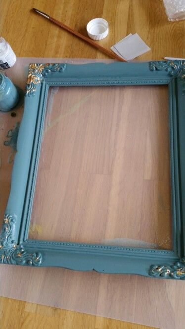 Old wooden frame painted in MMSMP'S Kitchen Scale and decorated with leaf gold..