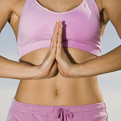 beat bloat and flatten your belly with these 14 yoga poses. #fitness #exercise #wellness | health.com