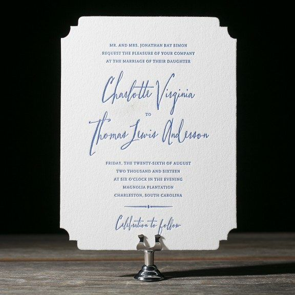 Anderson letterpress wedding invitations showcase a modern, typography based design by Jessica Tierney with a die-cut shape and floral envelope liners.