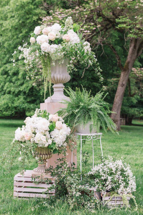 Elegant outdoor floral arrangement: http://www.stylemepretty.com/new-york-weddings/tarrytown/2015/08/06/elegant-garden-wedding-at-lyndhurst-castle/   Photography: Jen Chanyi - http://www.cyrience.com/