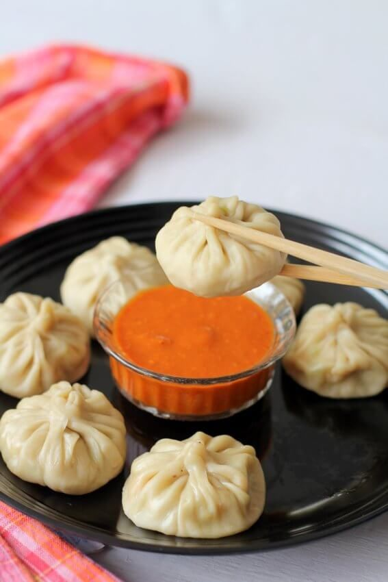 Veg momos recipe, a street food, chinese style steamed vegetable filling dumplings. Recipe of momos made in cooker easily. How to make veg momos with pics
