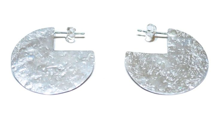 Sterling silver studs featuring an organic textured surface that dazzles in the light. £75