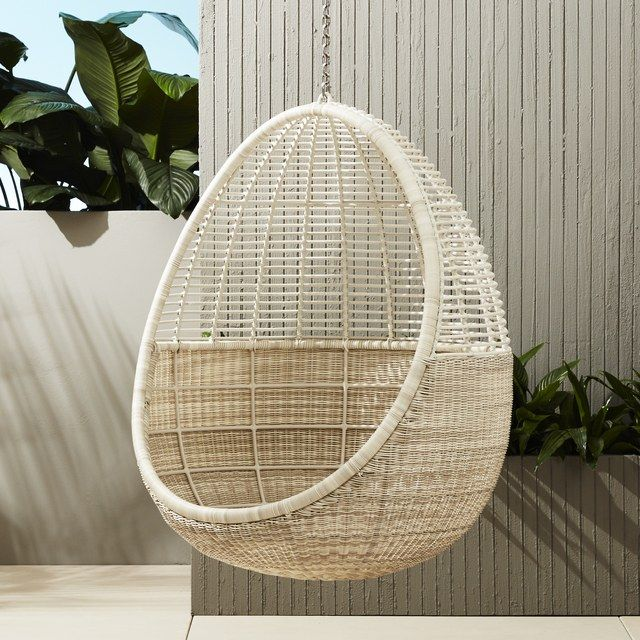 Two artisans dedicate seven days to the creation of just one durable faux-wicker Pod hanging chair by CB2; $699. cb2.com