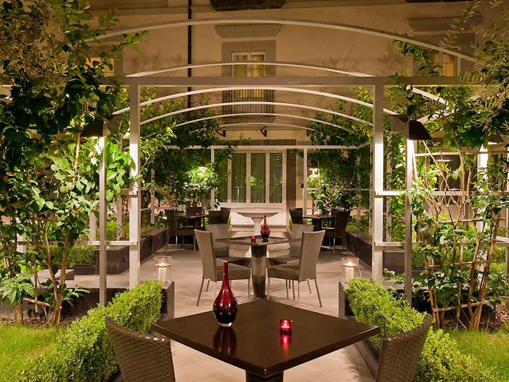 Dinner in the Mediterranean garden of Palazzo Caracciolo, Naples (Italy). Hotel with conference rooms.
