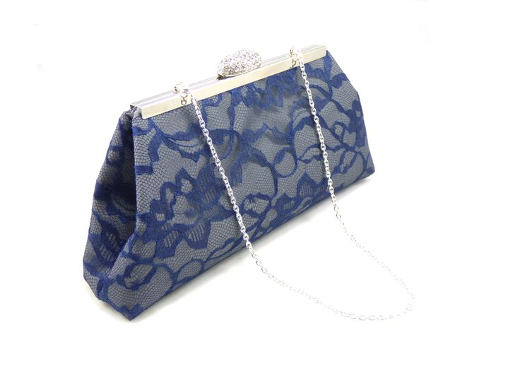 The perfect personalized bridesmaid gift, bridal clutch or Mother of the Bride gift! This beautiful clutch is made with a soft steel grey satin under a floral navy blue lace overlay. Open the bag to r