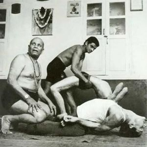 1990s: Pattabhi Jois and his son teaching yoga in India