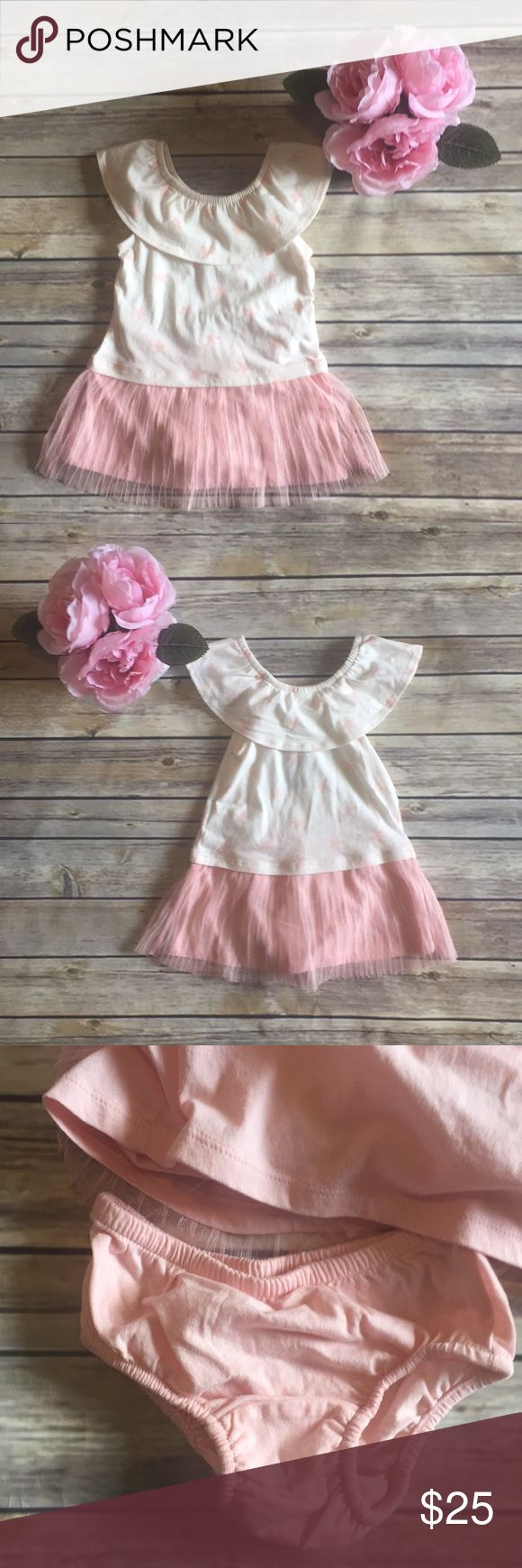 NWT Baby Gap dress NWT Baby Gap dress with bloomers in size 12-18 months.  Actual tag is missing, but bloomers are still attached with plastic, so listed as NWT.  Adorable star print on cream top with beautiful blush pink tulle over cotton.  Very soft and comfortable for baby!  Pet/smoke free home. GAP Dresses