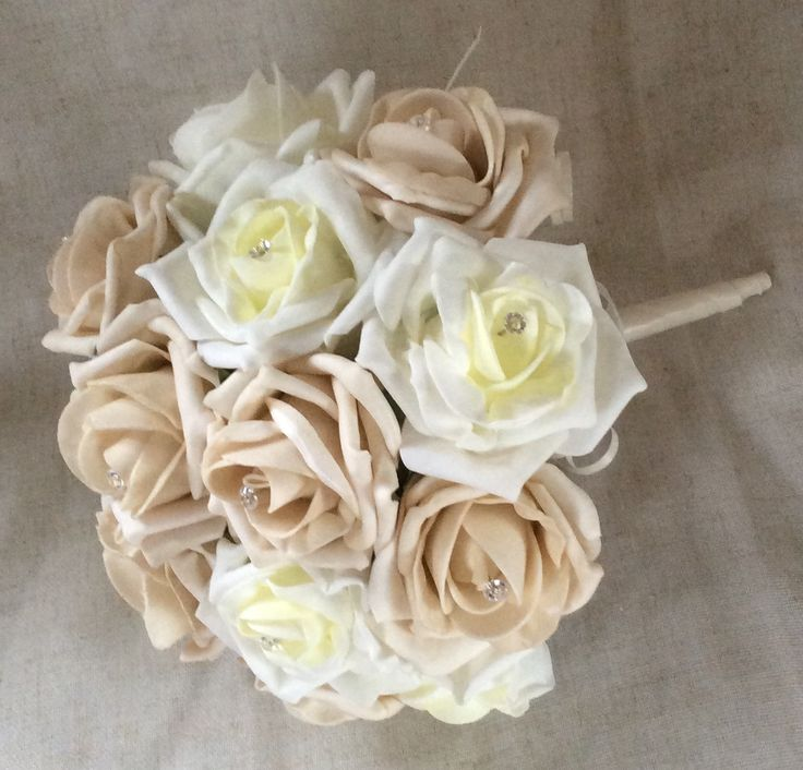 Poly foam mocca and ivory roses by Cathey's flowers