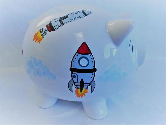 Your little aspiring astronaut will just love this piggy  bank painted with colorful rockets. Five in all around this large piggy bank. Visit my shop and see what's cooking in the design department!