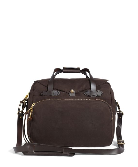"""Might as well have the best,"" is the mantra for legendary outdoor supplier Filson® and we at Brooks Brothers cannot help but agree. For a limited time, we're proud to offer a carefully curated selection of favorites from Filson® including this twill and bridle leather padded computer bag. Water repellent. Multiple compartments for storage. Two-way brass zipper. Brass hardware. Double bottom. Meets carry-on requirements. 16½"" x 14"" x 7½"". Wipe or brush clean only...."
