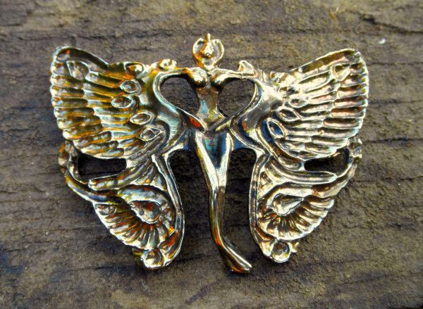 winged woman vintage belt buckle at the HEIDI ABRA Boutique.