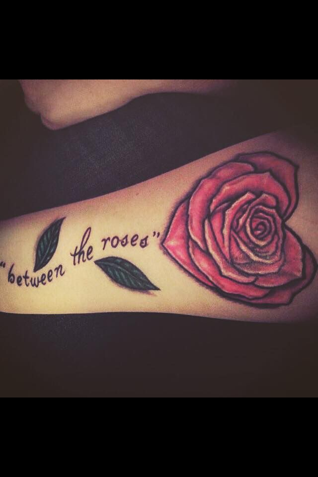 """Saywecanfly """"Between the Roses"""" tattoo"""