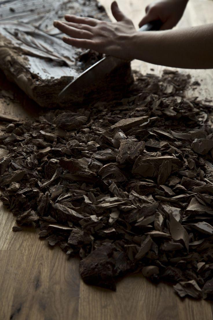 cutting a slab of dark chocolate