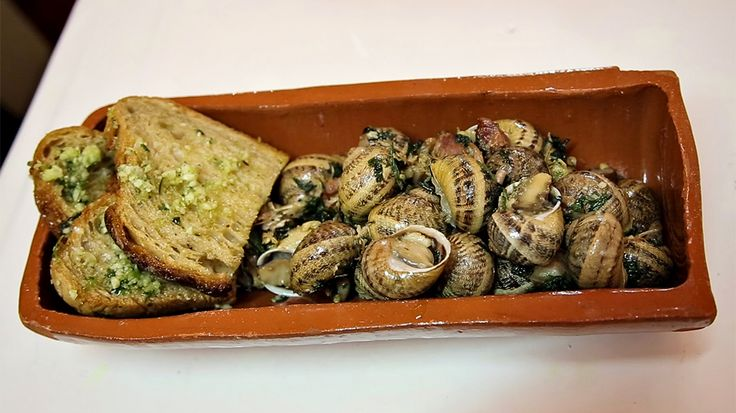 steamed snails on a plate : Bizarre Foods : TravelChannel.com