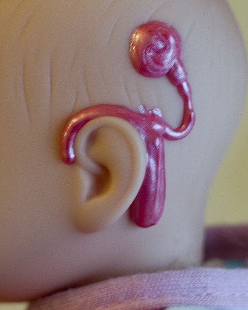 Great idea! Use fabric paint to draw a cochlear implant on baby for kids with hearing disabilities