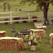 Outside seating with Firepit. Love it! When you are done with the straw bales you can use them to make a garden :)