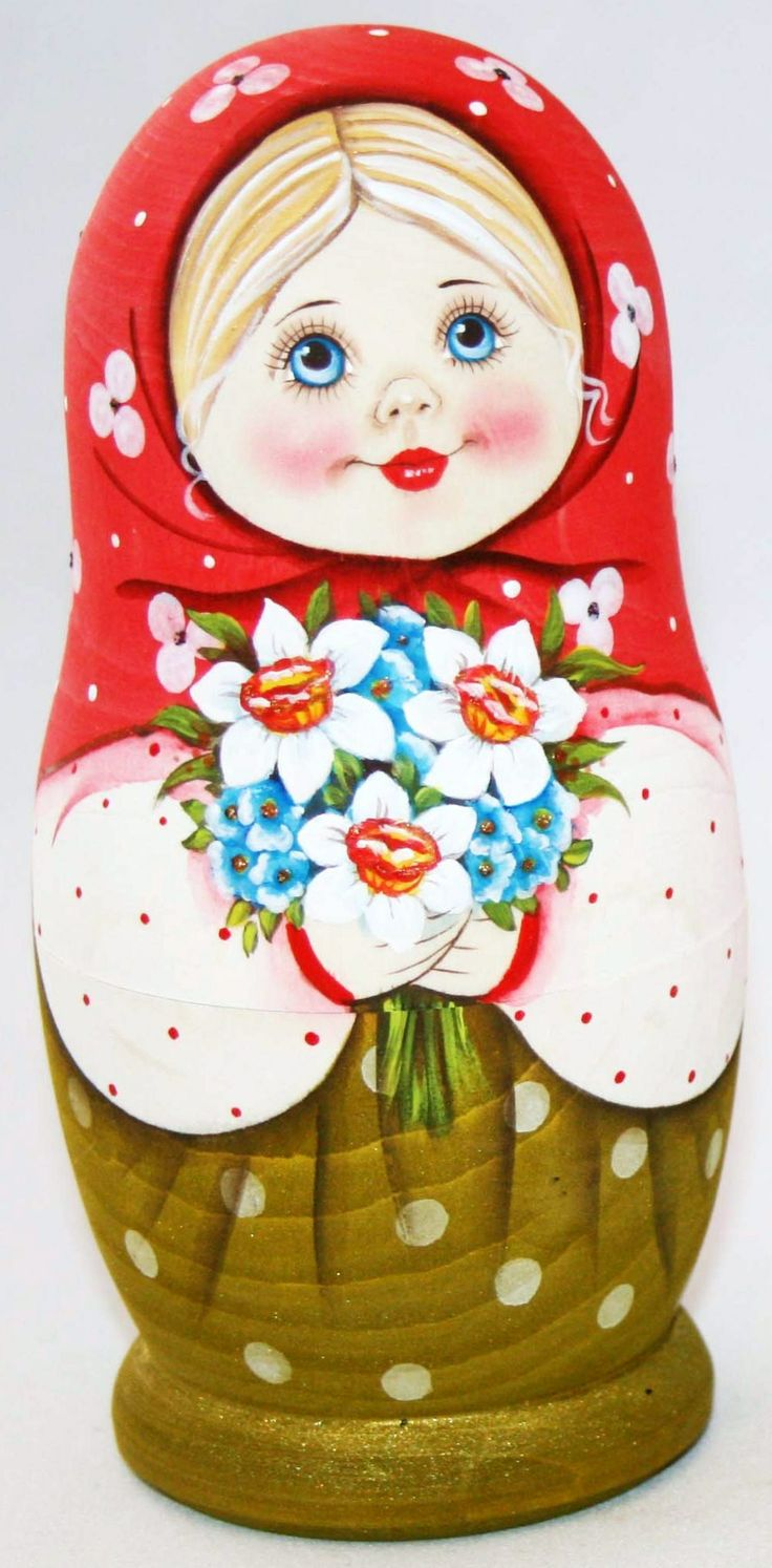 Pretty matryoshka (Russian nesting doll) in a red shawl with a bouquet in its hands. #Russian #folk #art #matryoshka