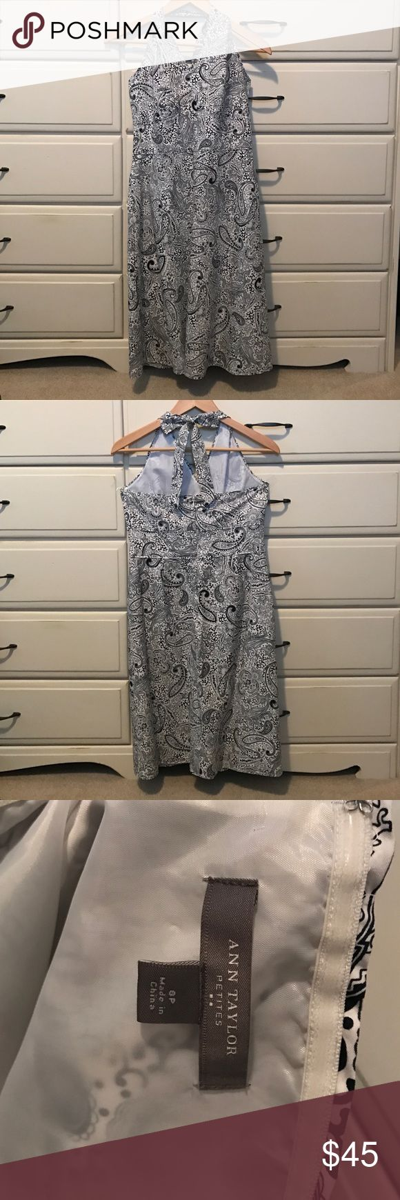 Ann Taylor Halter Dress 8 Petite Adorable Ann Taylor halter dress in navy and white Print. Size 8 Petite.  Back zip and neck tie in back.  Has sarin like lining.  Great dress for any occasion! Ann Taylor Dresses
