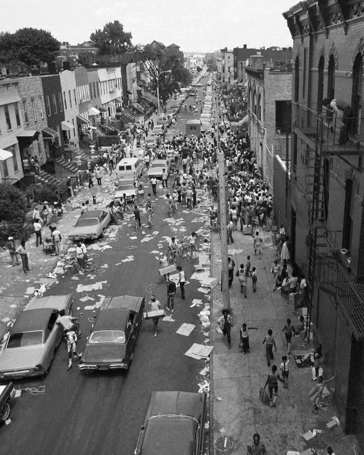 A street in Bedford-Stuyvesant is filled with trash and people following the looting resulting from the blackout in New York City on July 13, 1977. via reddit