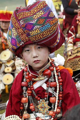 Tibetan girl in festive dress at the festival of Mani Genkok. Kham, eastern…