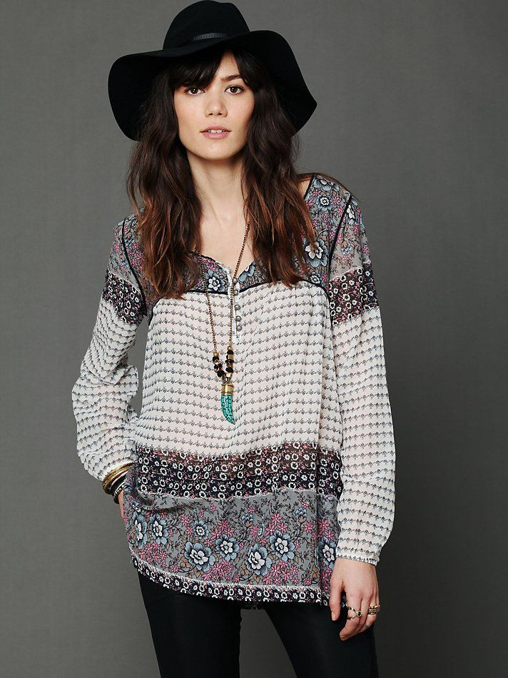 indian print tunic with black hat long necklace