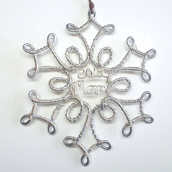 Wire Name Snowflake Christmas Ornament custom handcrafted with your favorite word or name and year. The silver snowflake is made with steel fencing