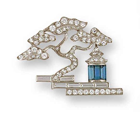 A late art deco diamond and aquamarine brooch, circa 1935  designed as a Japanese pagoda of rectangular-cut aquamarines and single-cut diamonds, shaded by a pine tree of round brilliant and single-cut diamonds, on a baguette-cut diamond base; unsigned, no. 31519; estimated total diamond weight: 1.20 carats; mounted in platinum
